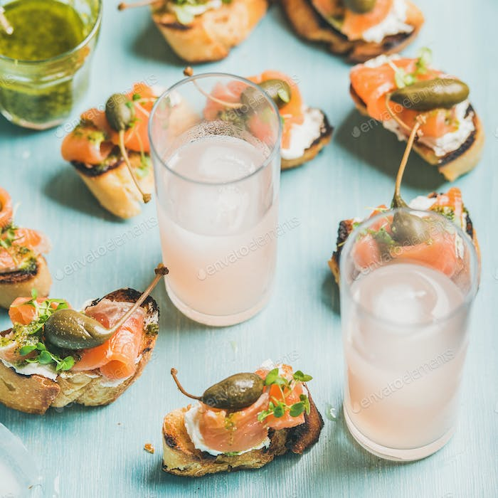 Crostini with smoked salmon and pink grapefruit cocktails, square crop