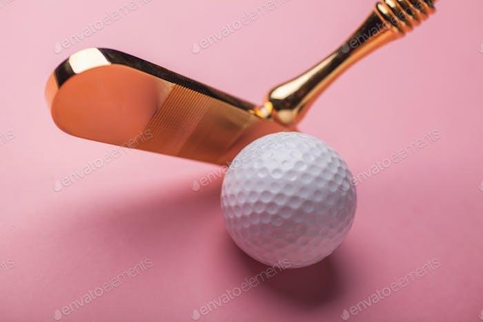 luxury gold golf club and balls