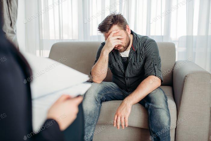 Sad patient at psychologist, psychology support