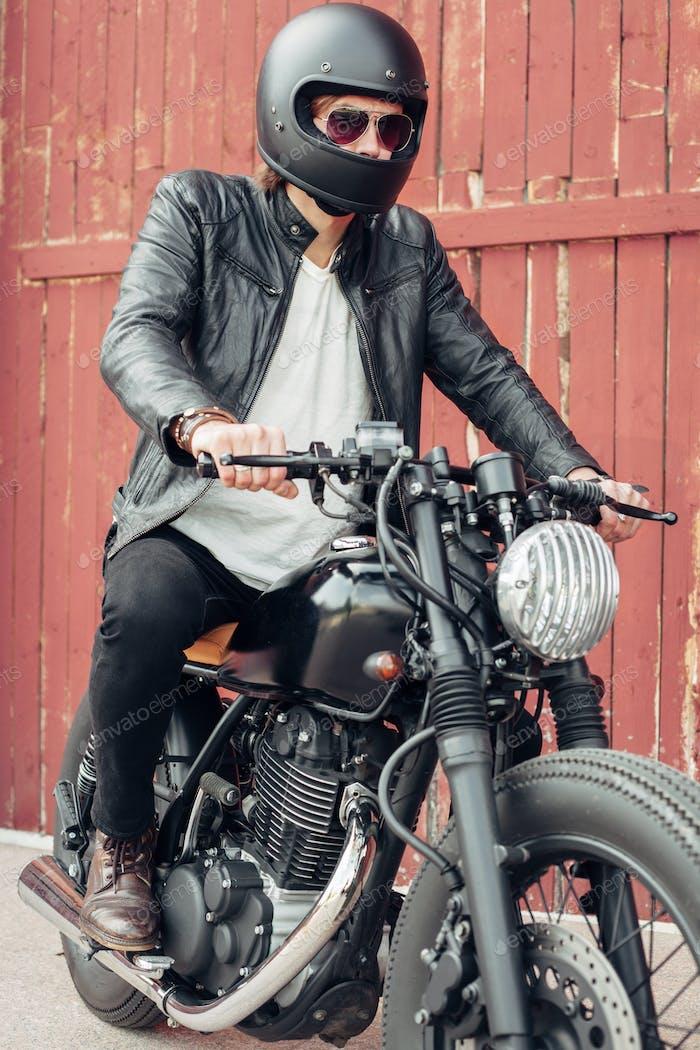 Biker and vintage custom motorcycle
