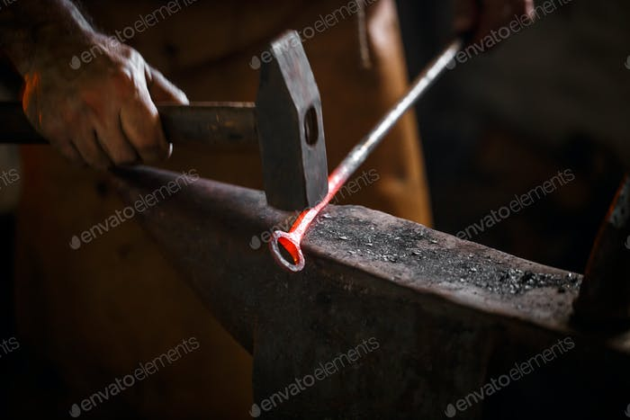 The blacksmith forge the hot metal