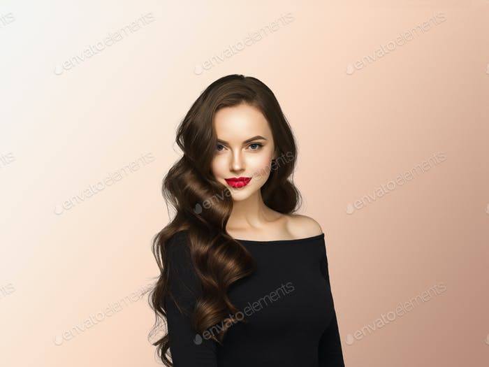 Beautiful hair woman with long brunette hair beauty healthy hairstyle. Beige background.