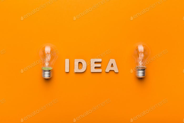 Creative background with light bulbs and Idea inscription