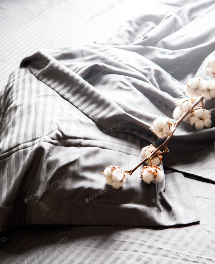Bedding is gray. Soft natural fabric is cotton, satin, linen.