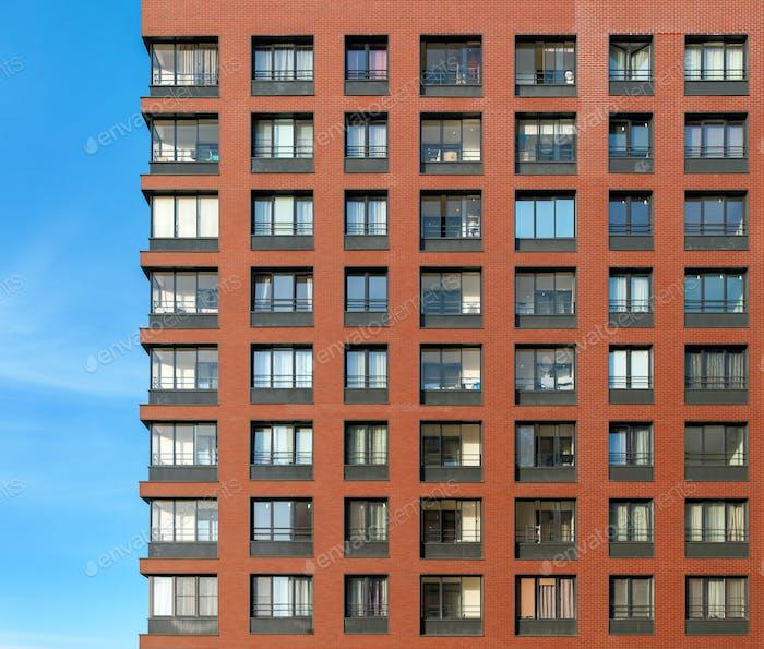 The modern brick facade of a high-rise building