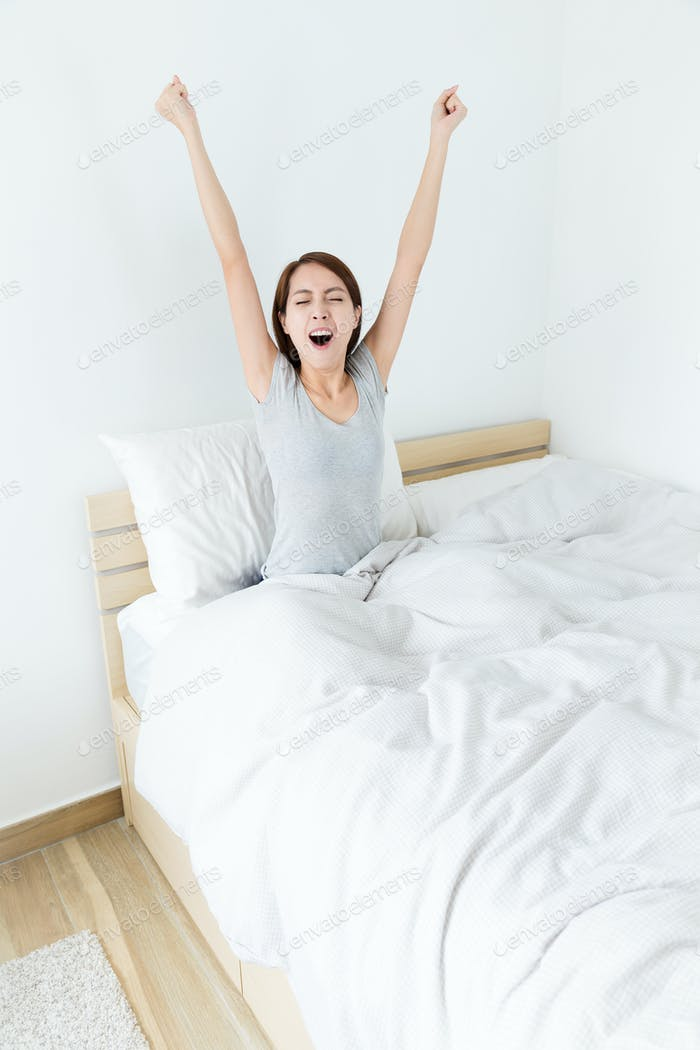 Asian young woman just wake up and yawning