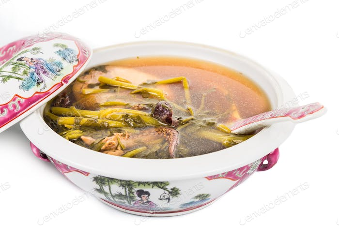 Casserole of Chinese watercress soup isolated in white
