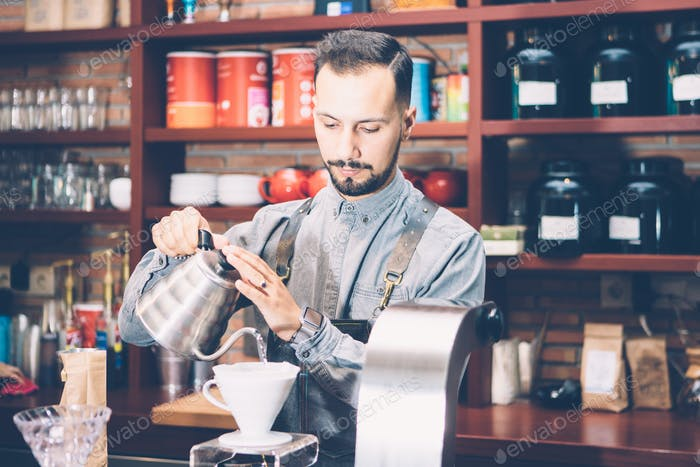 Bartender pouring water in chemex