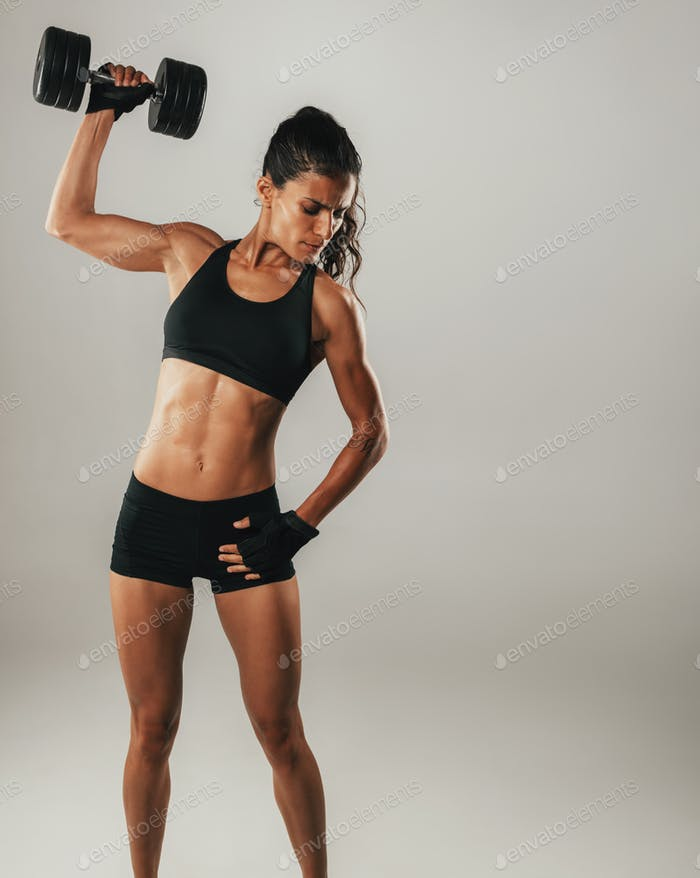 Fit strong young woman with a toned muscular body