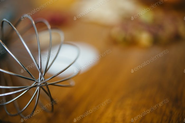 Focused egg whisk in close-up