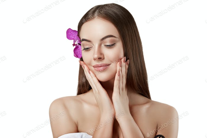 Woman beautiful portrait with flower orchid in hair isolated on white