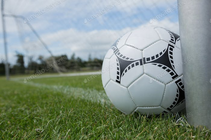 Soccer ball near a goal post