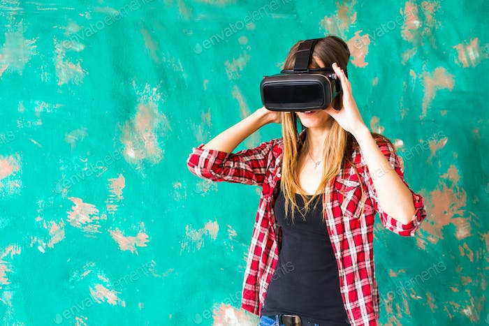 Young woman using the virtual reality headset