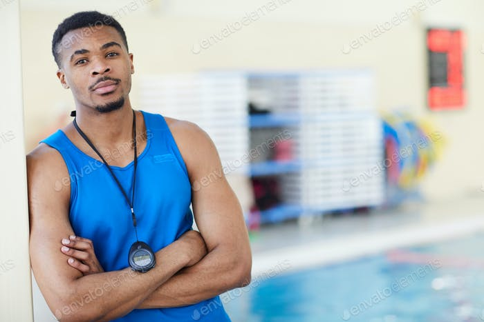 Male Fitness Instructor in Swimming Pool
