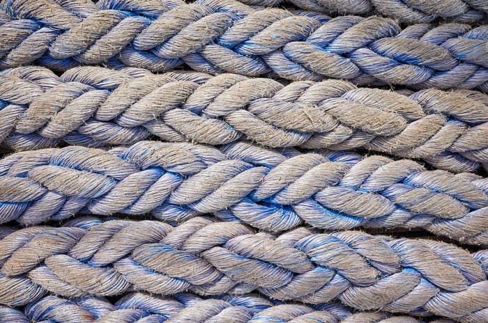 Close up picture of frayed boat ropes.