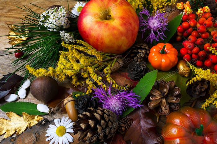 Fall greeting with cones and apple on wooden table