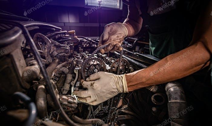Car mechanic in garage