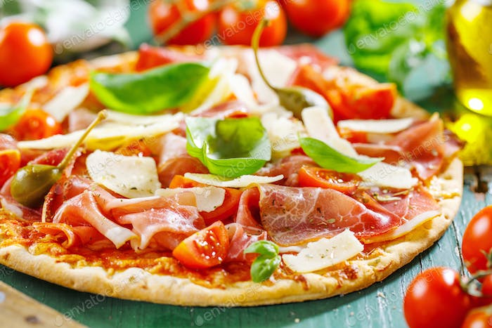 Appetizing italian pizza with prosciutto