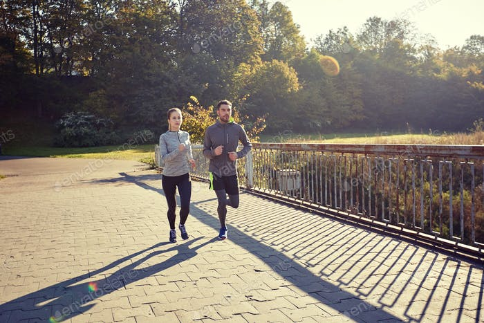 happy couple running outdoors