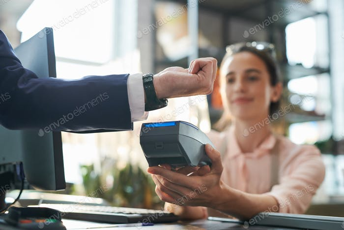 Businessman Paying by Smartwatch