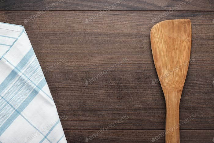 Wooden Spatula On The Brown Table