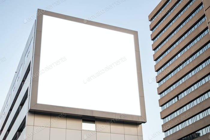 Blank billboard mockup for advertising on a building facade