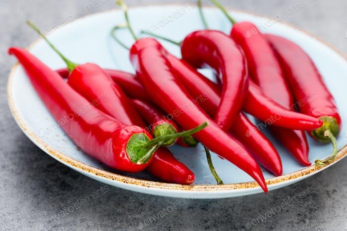 Chili cayenne pepper on grey background.