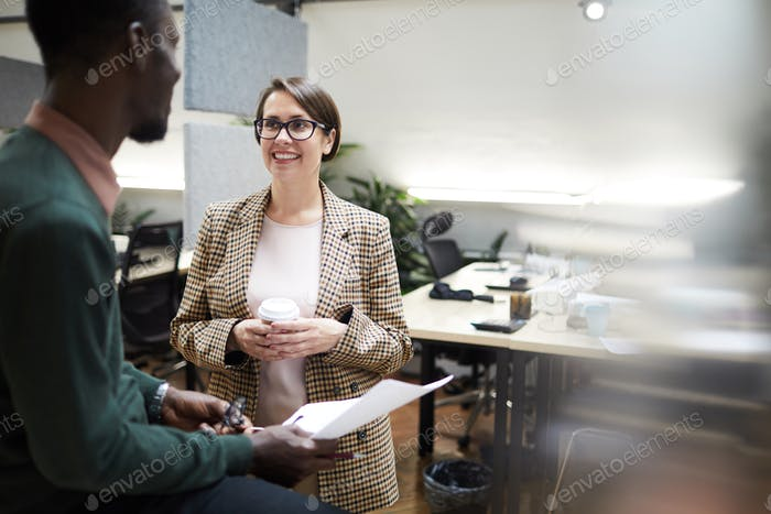 Smiling Business Manager Talking to Employee