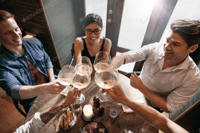 Group of people enjoying a glass of wine at cafe