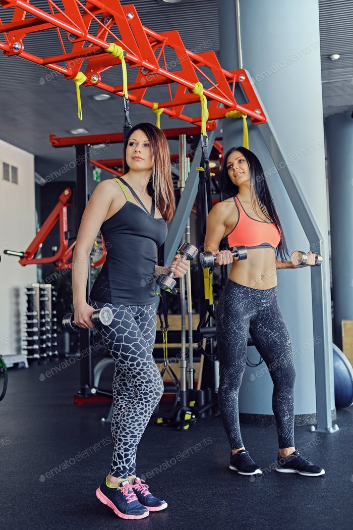 Two women with dumbbells.