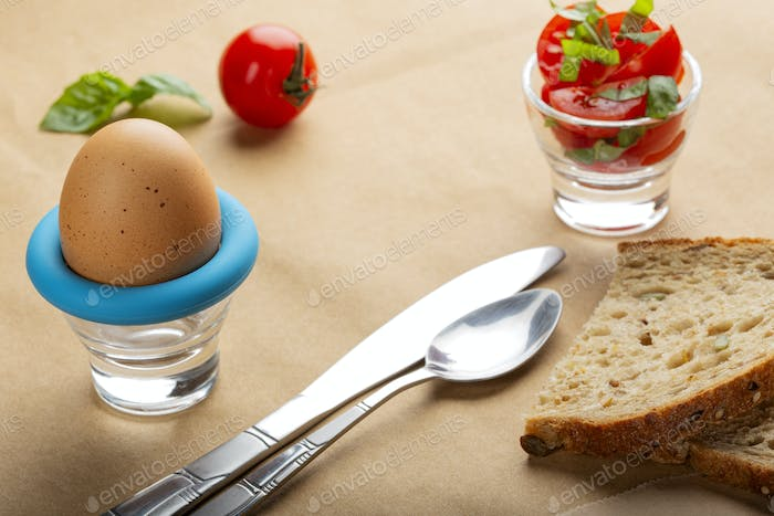 Boiled egg with bread and cherry tomatoes