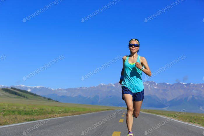 Fitness determined woman running on mountain trail