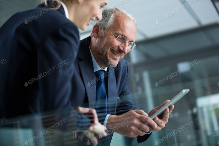 Businessman with colleague using digital tablet