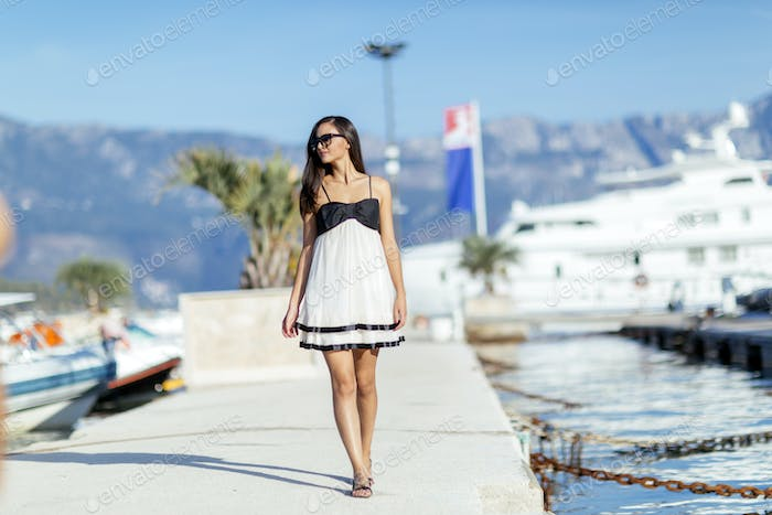 Beautiful woman in marina posing