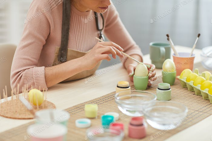 Unrecognizable Woman Hand-Painting Easter Eggs