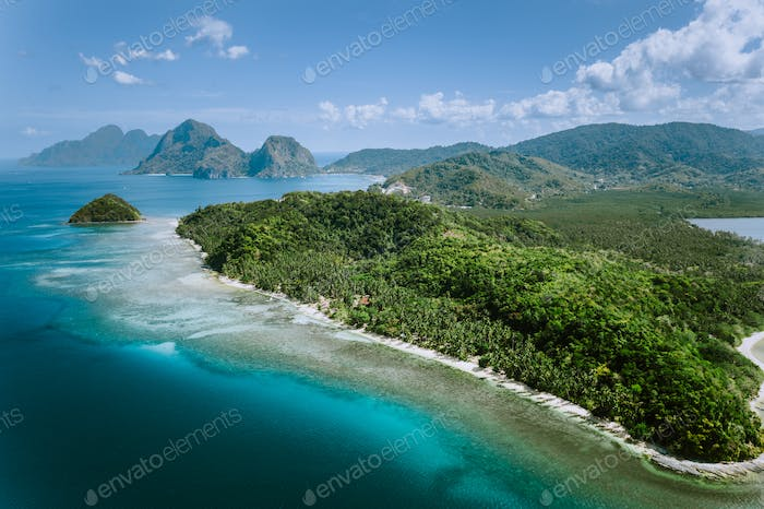 Aerial panoramic view of Palawan amazing coastline, majestic limestone cliffs and sea bay in El Nido