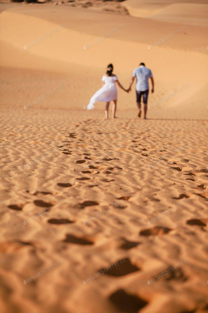 couple travel sand dune