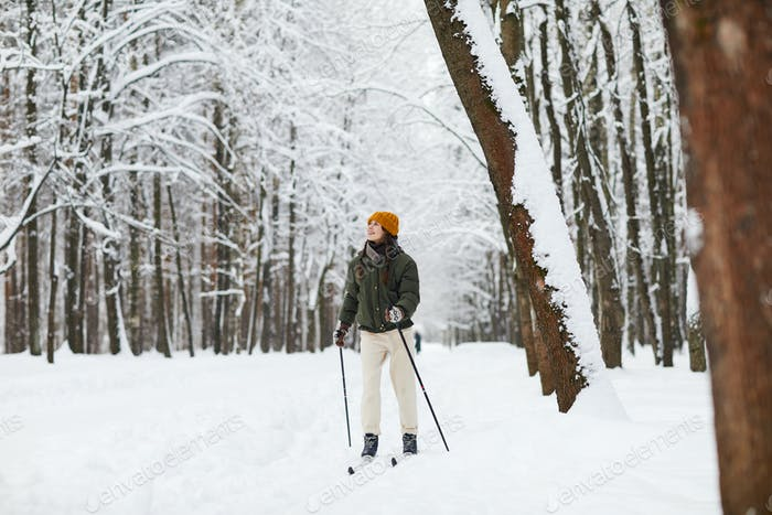 Active Woman Skiing in Forest
