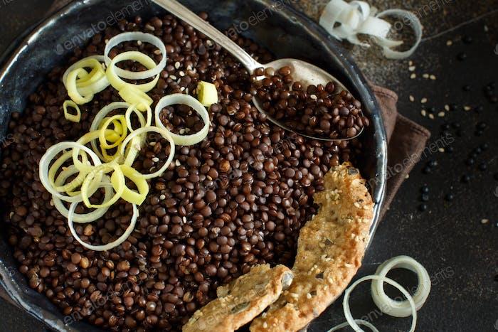 Black lentils and vegetables stew
