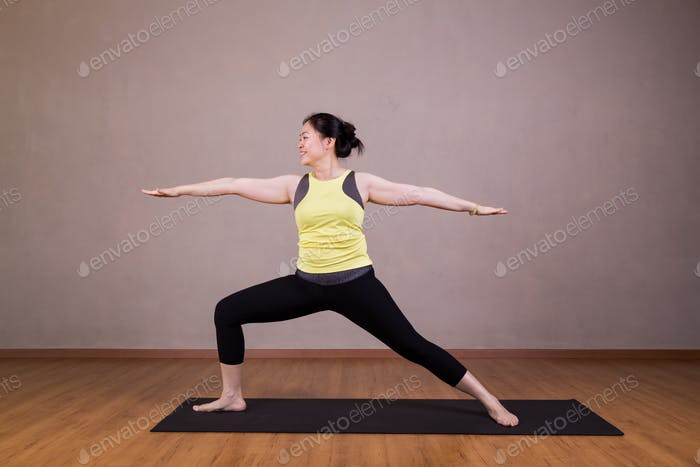Female performing the Warrior 2 or Virabhadrasana 2 yoga pose