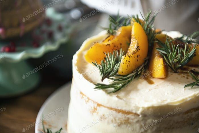 Buttercream cake with apricot and rosemary