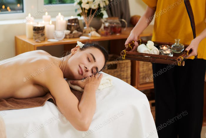 Woman relaxing during spa procedure
