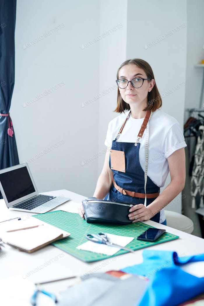 Female purse maker at work