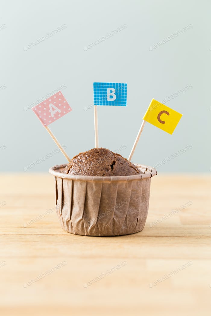 Chocolate muffins with small flag of word ABC