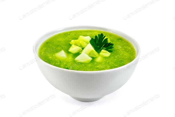 Soup cucumber with parsley in bowl