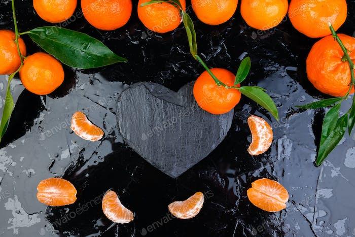 Tangerine around with black slate heart shaped.