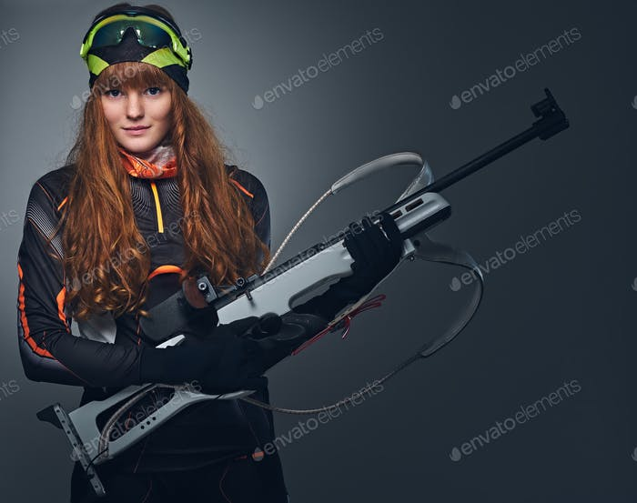 Studio portrait of a redhead female Biathlon champion.