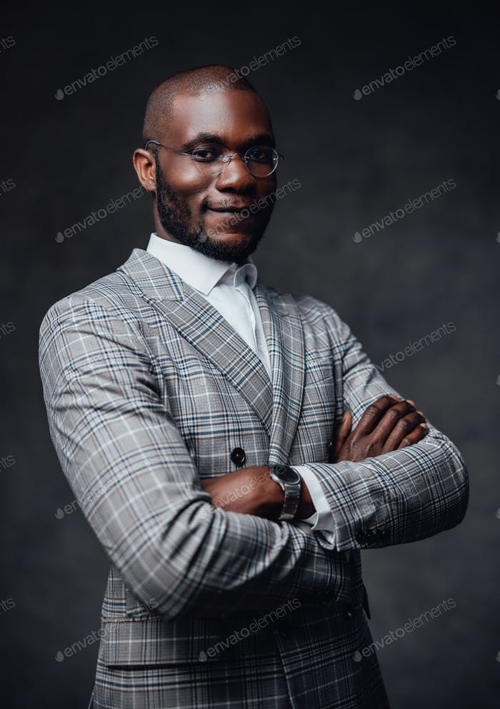 A serious business person with gray background behind