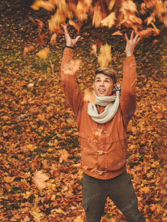 Happy man in autumn park