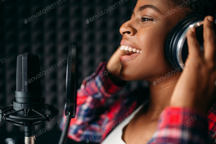 Female singer songs in audio recording studio